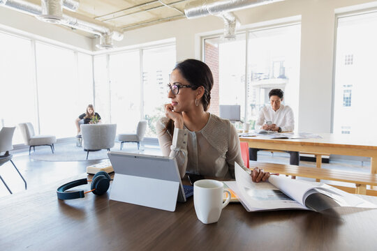 Woman at digital tablet in business coworking space