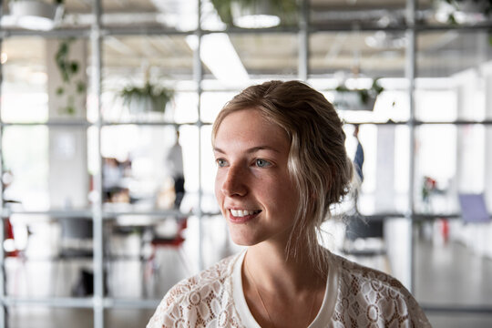 Portrait of woman smiling in business coworking space