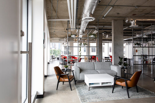 Coworking space with sofa in breakout area and work tables