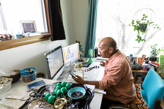 Man loading up jewelry to online shop
