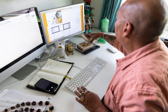 Man weighing jewelry for loading up to online shop