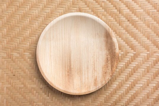 Betel palm leaf plate (Biodegradable plate, Compostable plate or Eco friendly disposable plate) on woven bamboo sheet