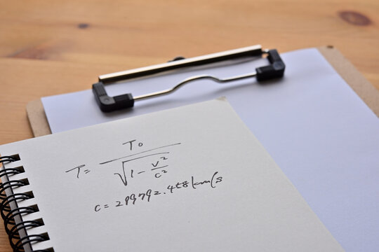 Close up of the notes with the formula for the law of universal gravitation.