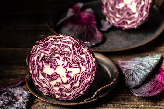 Shredded red cabbage Prepare sliced vegetable for cooking purple cabbage salad or coleslaw. Homemade food concept. Vegetarian healthy food