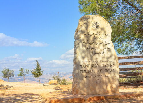 Mount Nebo, Jordan - Jan 3, 2020: Memorial stone of Moses of Promised Land at Mount Nebo, 710 meters above sea level. The view from the summit a panorama of land and valley of River Jordan.