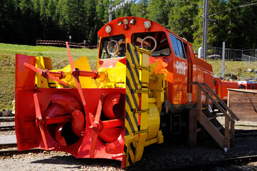 Fototapeta The Xrot snow clearing machine of the Unesco World Heritage Bernina train ist he strongest in the world and moves 8 500 t/h away and is clearing 6 m wide obraz