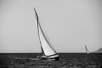 Wall Mural - Luxury sailing. Sailboat in the regatta in the Aegean Sea. Black and white photography.