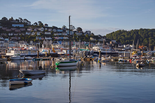 A crowd of boats moored in the harbour in the estuary of the River Dart, at Dartmouth, on the south coast of Devon, England, United Kingdom
