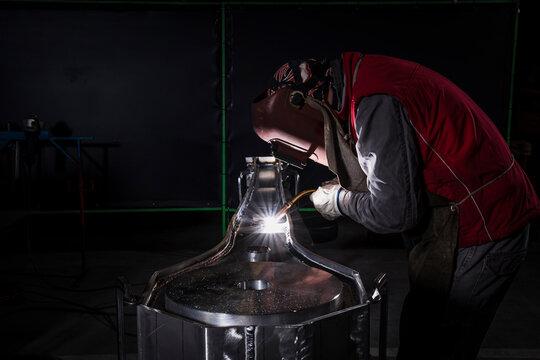 Welder that welds aluminum in his workshop