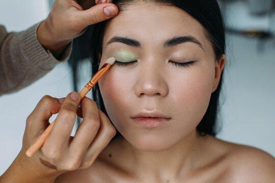 Make up artist apply eye shadows