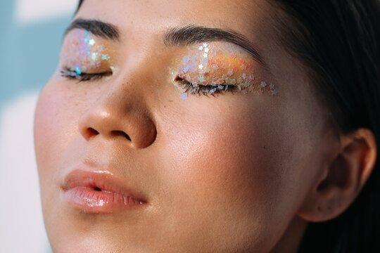 Beauty portrait with little rainbow on skin
