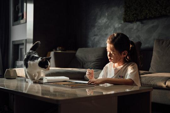 Cute little girl doing homework at home