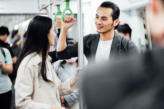 Business people traveling together in subway