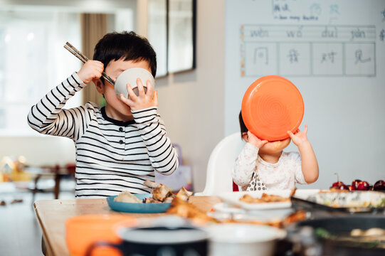 Asian children eating at home