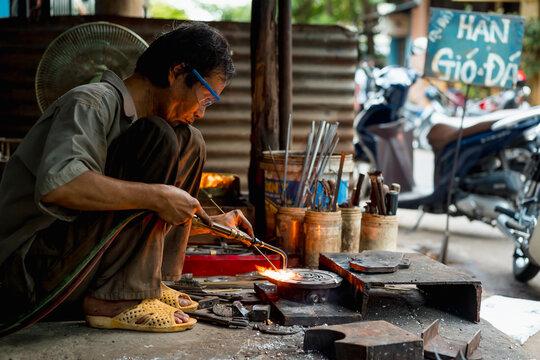 Man working in a mechanical workshop in Vietnam