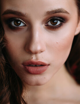 Closeup beauty portrait of woman with evening make up