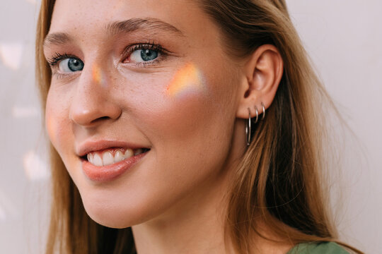 Woman with small rainbow on her face