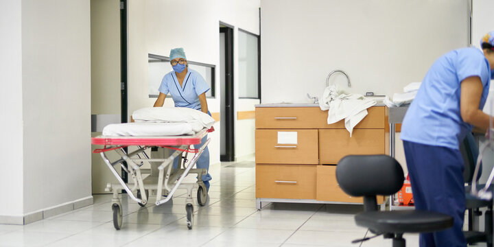 Nurse preparing a movable bed in a hospital