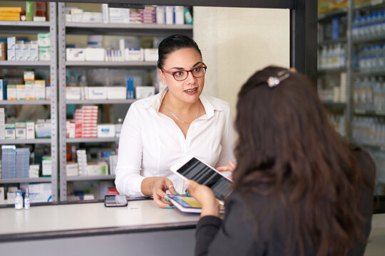 Pharmacist talking with a sales rep