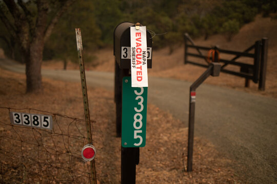 """A sign reads """"Evacuated"""" at the entrance to a residence near the Glass Fire in Calistoga, California"""