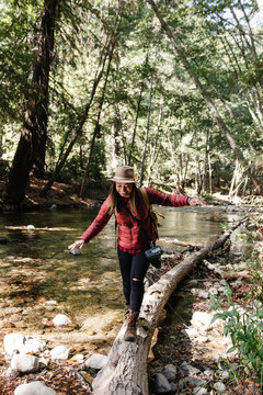An African American woman explorer, hiking and taking photos in nature.