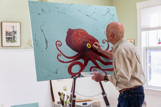 Contemplative Senior Man Painting in Home Artist Studio