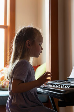 Young Child Learning to play Piano on Video Chat