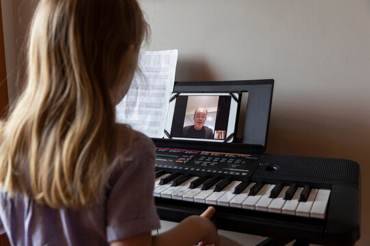 Young Child Learning to play Piano via Video chat