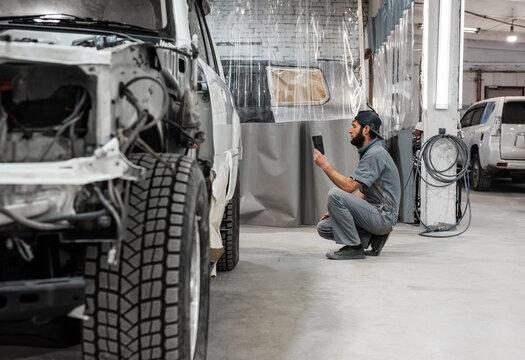 Bearded man working in garage