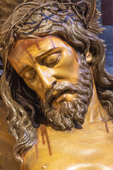 BARCELONA, SPAIN - MARCH 5, 2020: The detail of carved statue of Jesus on the cross in the church Església de la Concepció from 20. cent.