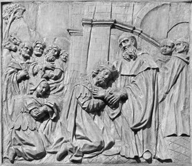 CATANIA, ITALY - APRIL 7, 2018: The baroque carved relief from live of St. Benedict (with the Totila king of Ostrogoths) on the gate of church Chiesa di San Benedetto.