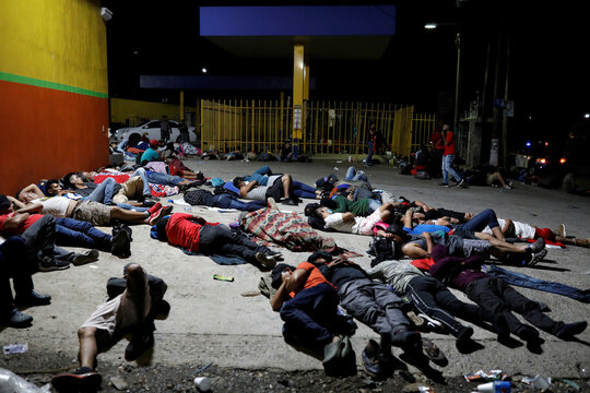 Honduran migrants trying to reach the U.S. sleep on the floor after a long day of walking in the town of Entre Rios
