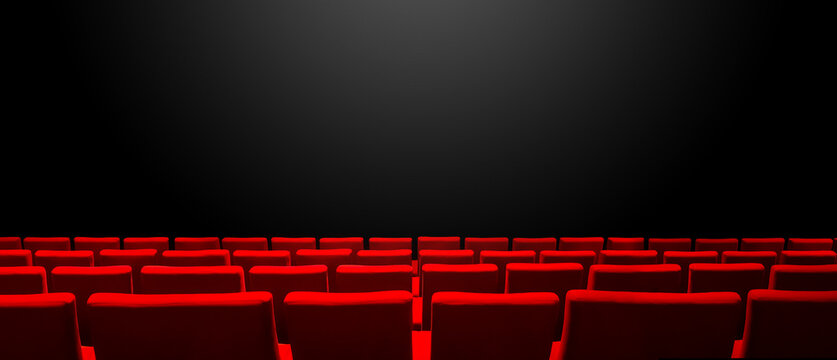 Cinema movie theatre with red seats rows and a black background. Horizontal banner