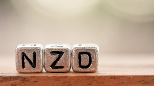 """Three silver blocks placed in a row labeled """"NZD"""". Concept Used about New zealand currency articles."""