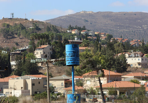 """A U.N. """"blue line"""" notification is pictured near the Lebanese-Israeli border as seen from the southern Lebanese village of Khiam"""