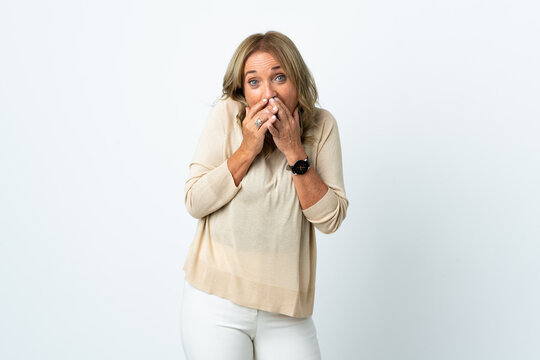 Middle aged blonde woman over isolated white background happy and smiling covering mouth with hands