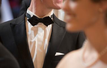 man wearing a bow tie Fotobehang