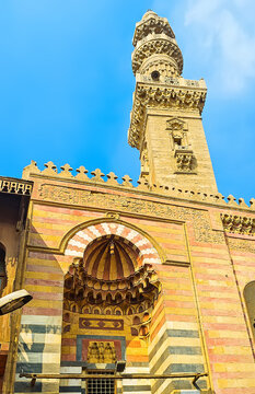 The facade of Sultan Al-Ashraf Barsbay Mosque with ablaq pattern, on Oct 12, 2014 in Cairo, Egypt