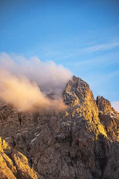 Mountain peaks in clouds, like smoking mountains.