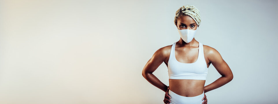 Fitness woman with face mask