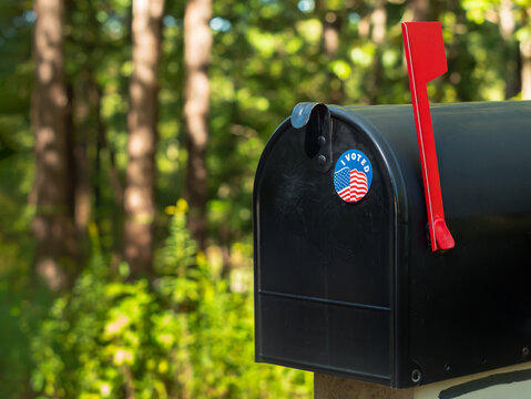 I Voted sticker on a residential mailbox. Absentee voter vote by mail.