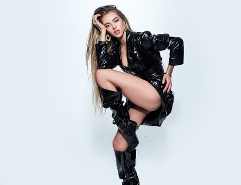 Sexy woman legs in high black boots. Mistress lady, kinky. Fashion female high heel boots.