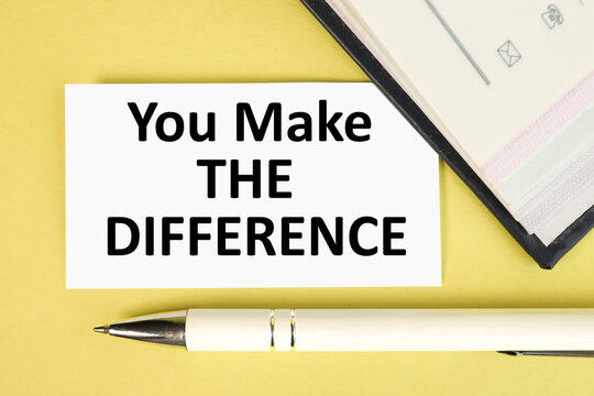 you make the difference, text on white paper on yellow background near white pen