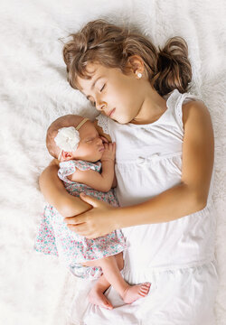 newborn toddler with older sister. selective focus.