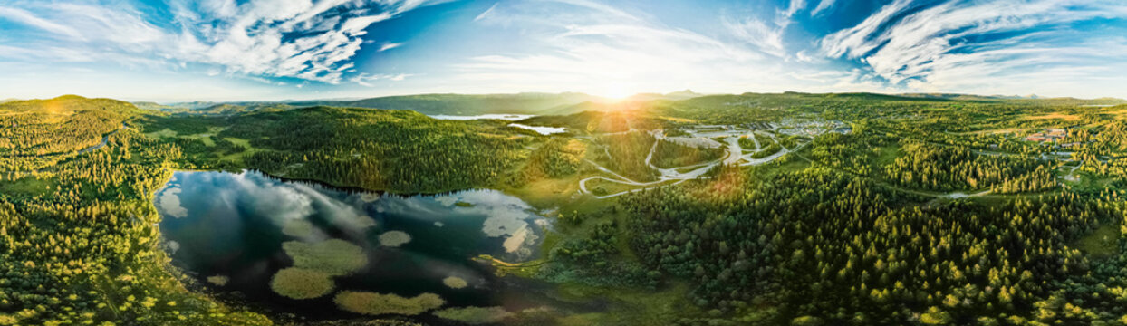 Bamselitjernet lake near Beitostolen surrounded by forests during sunset, Norway