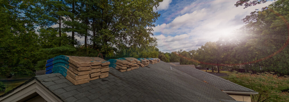 Shingle Bundles Stacked on Roof to Repair Storm Weather Damage
