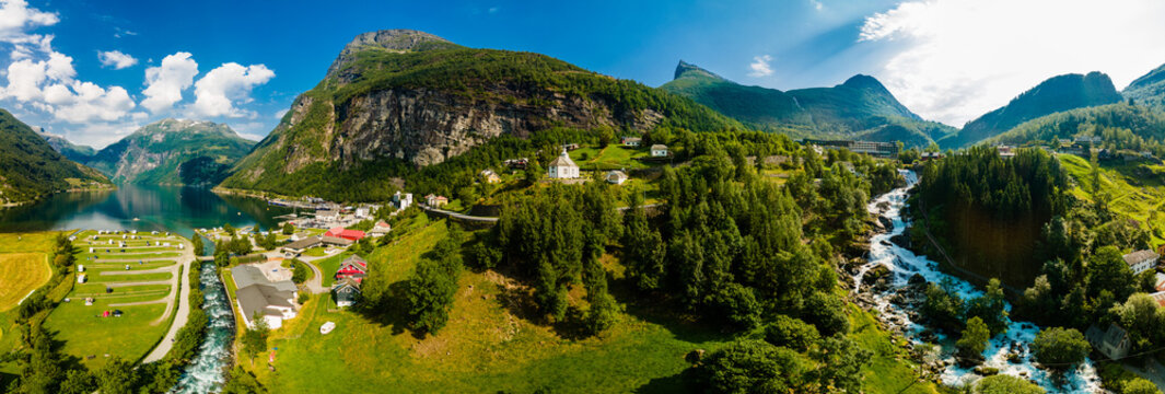 View of the river Geirangerelvi and the waterfall Storfossen in Geiranger, Norway.