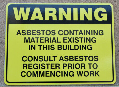 Warning about asbestos existing in the building signage.