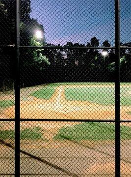 Empty baseball diamond at night