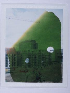 Polaroid image with green spot.